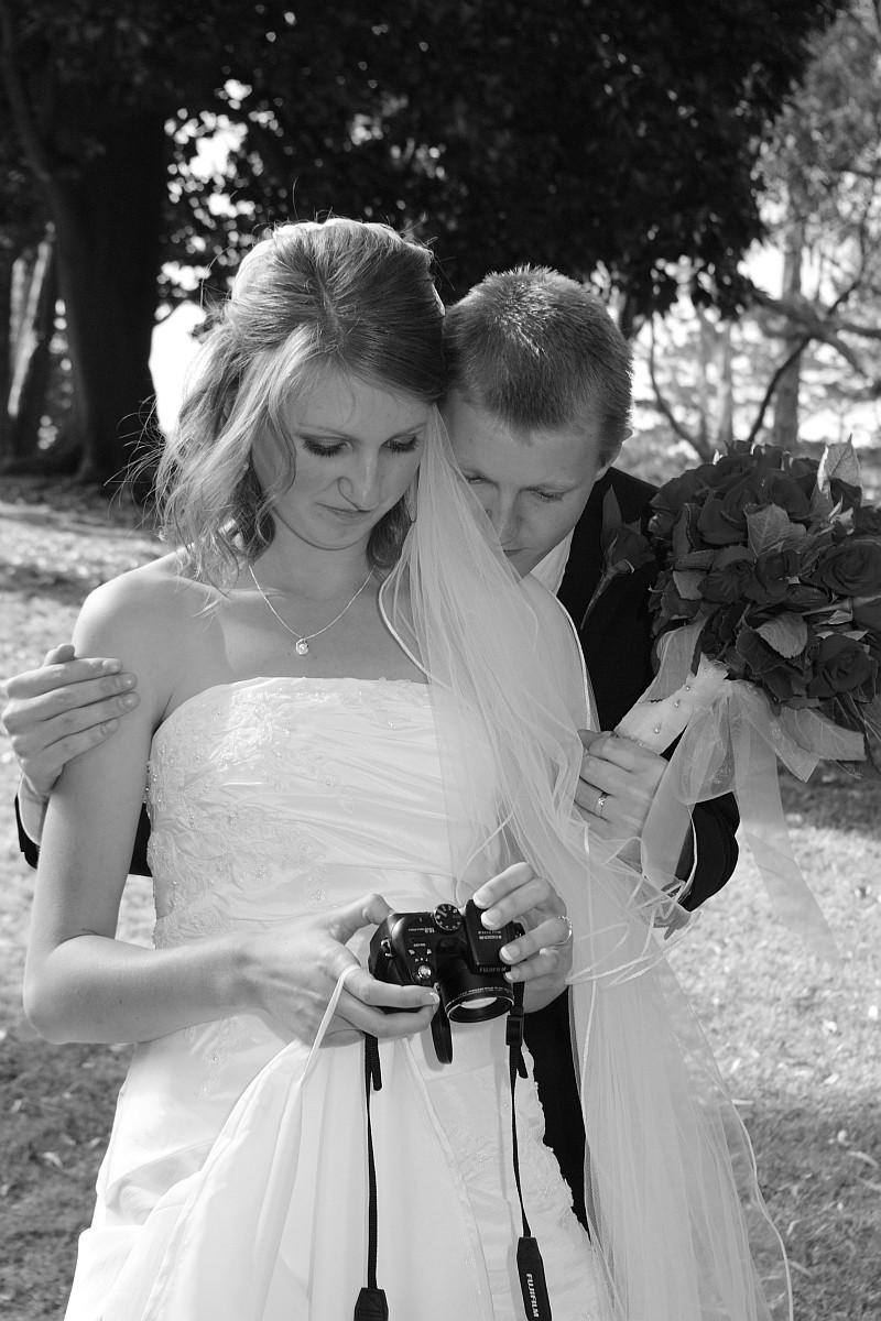 BrideChecksPhotos.jpg