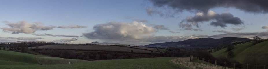Left to right.  Brown Clee, Titterstone Clee then the wooded hill of Bringewood..jpeg