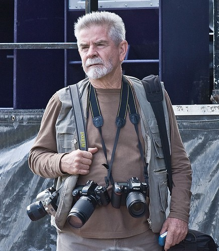 photographer-with-multiple-cameras-hanging-from-straps.jpg