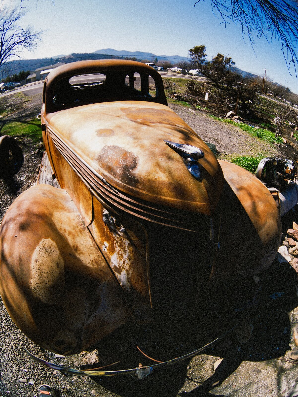 Q7_Mar2_21_fish-eye_burned_jalopy_#2.jpg