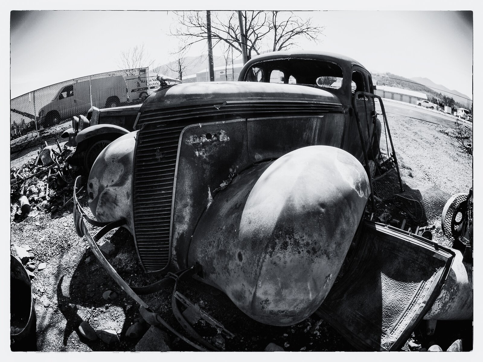 Q7_Mar2_21_fish-eye_burned_jalopy_#3(b&w).jpg