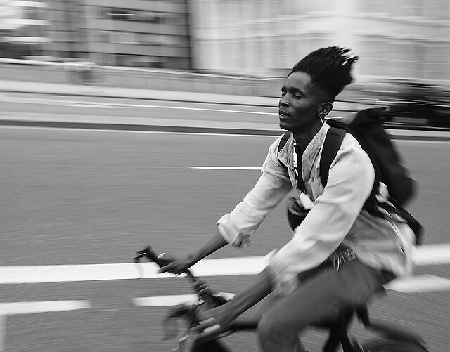 Cyclists - Panning Shots - Panning is a hard one for me.  The movement required at the waist to follow through, and the tremor in my hand......they both conspire to defeat me.  During rush hour out of about 200 shots I managed to get these.  Not the sharpest but they give an indication of speed.  They were taken on London...