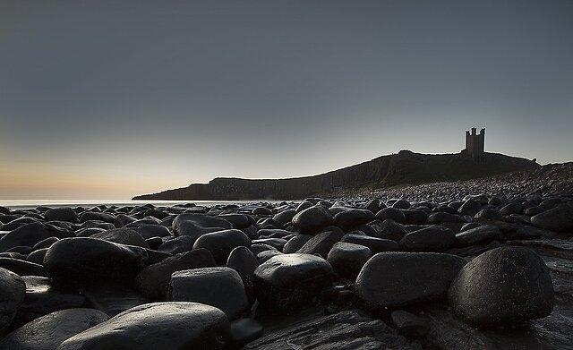 Post an image of yours related to the one above it! - Dunstanburgh Castle at Sunrise