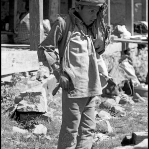 Boy at temple in the hills