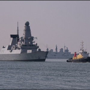 SD Adept and HMS Defender
