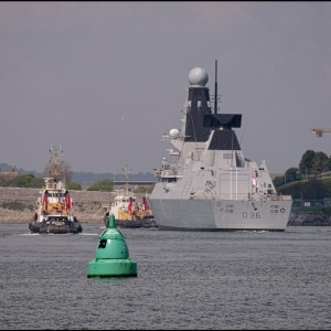 HMS Defender and tugs