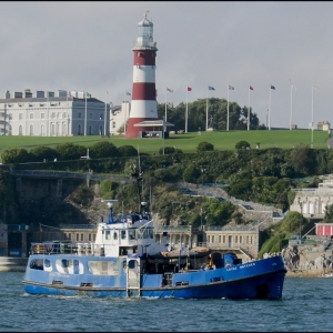 Dive vessel passing below Smeaton's Tower