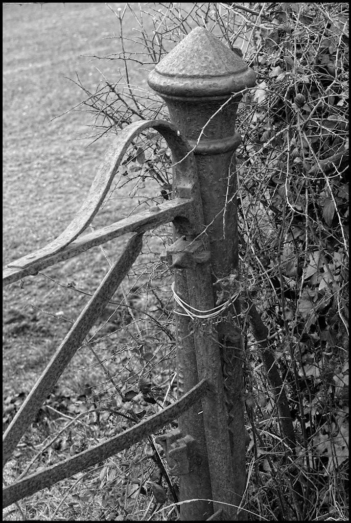 Ornate farm gate and post